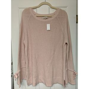 Women's pink sweater with flared sleeve detail